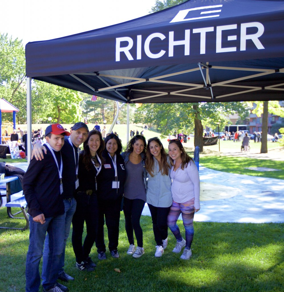 Alana and volunteers outside under a Richter branded canopy